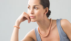 Model wearing pearl jewellery